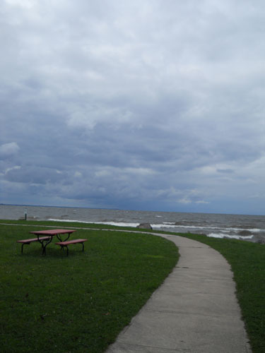 A picnic table sits at one edge of Sylvan Beach on Lake Oneida