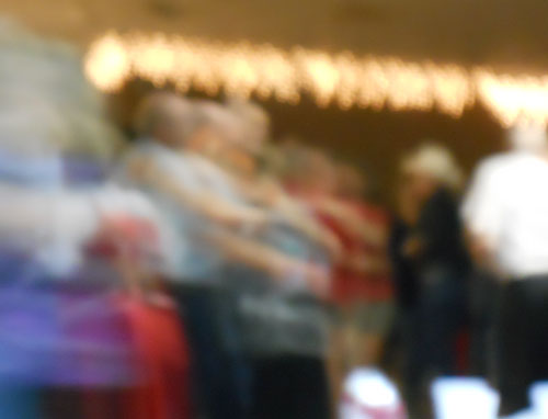 An blurry action photo of polka dancers dancing