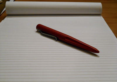 A capped pen lays on a blank page.